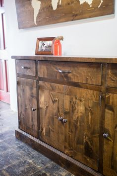 You can't go wrong with this multi-functional, beautifully handcrafted organizational dream: three drawers, four doors, and shelving inside, leaving room to house just about everything you can think of. The possibilities for this piece are endless.