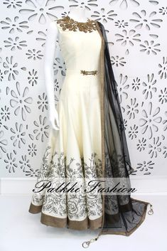 White designer suit worked along the torso in zardosi, zari & katdana embellishments while the flair is highlighted with black floral print embossed in gold Pakistani Fashion Party Wear, Indian Fashion Dresses, Indian Gowns Dresses, Dress Indian Style, Indian Designer Outfits, Pakistani Dresses, Indian Outfits, Designer Dresses, Long Dresses
