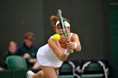 Agnieszka Radwanska with a running backhand stroke - Chris Raphael/AELTC