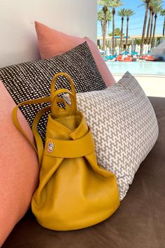 Stella makes a great poolside bag. For a larger bag, fasten the strap to the back to carry as a square tote. Either way carries as a backpack. Outside zip pocket. Inside small zip pocket plus 2 cell phone size slip pockets. Zip closure and comfy wide straps. This mustard color is one of our favs. #purse #pursesandbags #bags #tote #backpackstyle #summerbag #yellowpurse #yellow Italian Leather Handbags, Yellow Purses, Leather Backpack Purse, How To Make Handbags, Stitching Leather, Summer Bags, Clutches, Fashion Backpack, Mustard