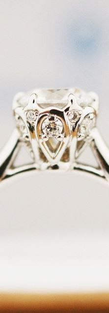 The gorgeous detail of this diamond engagement ring is absolutely stunning.