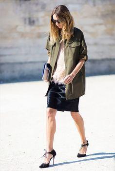 Army jacket, black midi skirt, heels and a fringe blouse.