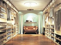 Huge closet:  Her's on one side, His on the other.  Love the sitting area with columns.
