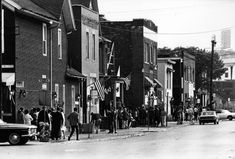 People gather outside buildings at the corner of Plum Street and Fourth, Detroit, Michigan. At the far right Briggs Stadium can be seen (Tiger Stadium) Mid - Detroit Downtown, Detroit Rock City, Detroit Art, Detroit History, Detroit Riots, Flint Michigan, Detroit Michigan, Old Pictures, Old Photos