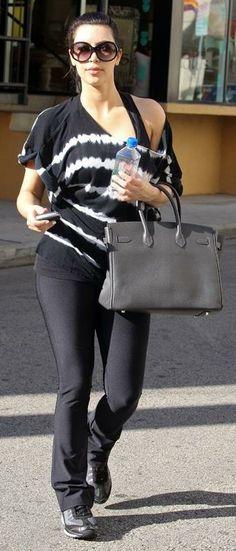 Who made Kim Kardashian's black sneakers, tie dye shirt, sunglasses and tote bag that she wore on March Shirt – Bebe Shoes – Skechers Purse – Hermes Sunglasses – Tom Ford Black Birkin Bag, Skechers Shape Ups, Kim K Style, Tom Ford Sunglasses, Kardashian Style, Black Sneakers, Striped Tee, Dye Shirt, Celebrity Style