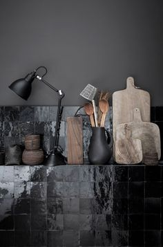 Beautiful black tiles against black wall in a kitchen really sets off the wooden tools. Someone speculated these are Zellige tiles. Kitchen Interior, Interior And Exterior, Kitchen Decor, Kitchen Stuff, Design Kitchen, Kitchen Lamps, Kitchen Display, Interior Office, Kitchen Styling