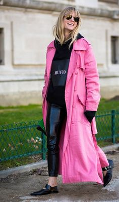 A hoodie layered under a pink duster.