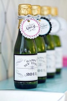 relabel bottles of sparkling cider for each person to bring home new years wedding