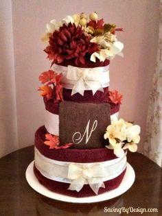 Custom towel cake made with the couple's bridal registry towels for a fall wedding gift | SavingByDesign.com