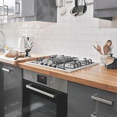 Grey gloss kitchen cupboard doors (bad handles)