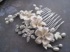 Bridal silver ivory flower rhinestone wire wrapped hair comb. $38.00, via Etsy.