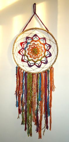 Inspiration :: Colorful dream catcher, a crocheter's free-form interpretation. Embroidery hoop wrapped with jute twine to cover, plenty of colorful yarn scraps. Dreamcatchers, Beautiful Dream Catchers, Crochet Dreamcatcher, Art Du Fil, Hoop Dreams, Jute Twine, Crochet Home, Crochet Doilies, Wind Chimes