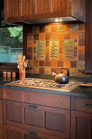 In An Arts U0026 Crafts Revival Kitchen, An Artistic Tile Panel By Handcraft  Tile Co. And Oak Cabinets Lend Appeal To A Kitchen With Modern Appliances.