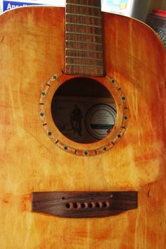The soundhole rosette is a genuine wood mosaic inlay. I think it lends itself well to that beat up/grunge guitar look, like from Texas or an old Mexican guitar.