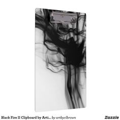 """Stay organized, and stunningly stylish, with artist-designed clipboards from Zazzle! The Black Fire II Clipboard designed by Artist C.L. Brown features fire photography converted to black and white. Design turns a basic school or work supply into a stunning accessory fit to keep you organized. Designed for letter and A4 sized paper this clipboard holds up to 0.5 inches of paper securely and is printed on both sides. Dimensions: 12.5""""l x 9""""w; thickness: 0.125""""."""