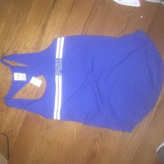 Victoria's Secret BRAND NEW pink tank This Victoria's Secret pink tank is brand new with tags attached. Size small with a loose fit never worn before completely new paid 25 dollars for it I don't like the way it fits on me. Never wore it out only tried it on. Victoria's Secret Tops Tank Tops