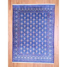 With a distinctive style, a gorgeous area rug from Iran will add some splendor to any decor. This Kashan area rug is hand-knotted with a floral pattern in shades of navy, ivory, red, light blue, burgundy and red.