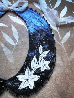leather, embroidery, silk, lace and crystals by adrianadelfino.com