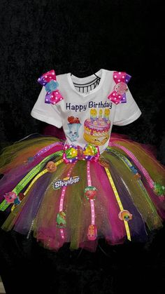 This listing is for Shopkins inspired tutu and shirt combo.Tutu is multicolored and embellished with ribbon jewels. Let your child's imagination run wild with this colorful fun tutu set and be the bir