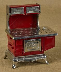 Kenton cast iron and nickel Favorite toy stove, 10 3/4'' h., 8 3/4'' w.
