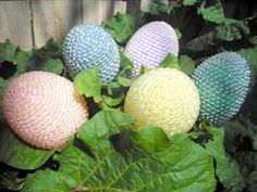 Beaded Easter eggs.  Hot glue bead trim onto plastic Easter eggs for an awesome professional Easter egg look.