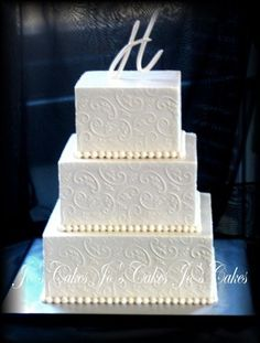 Three Tier Square Wedding Cakes | All buttercream stencilled with a leaf and scroll design.