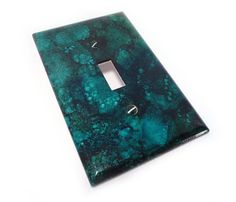 Deep teal light switch cover --- an Etsy treasure.
