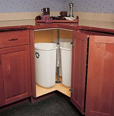 Rotating corner cabinet garbage