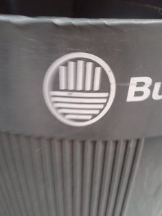 """This is the """"logo"""" the municipality uses in Buenos Aires street furniture. Here you can see the logo on a recent trash can in a pedestrian area."""