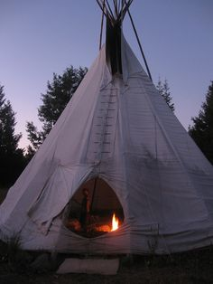 Tipi at night, via Flickr. We lived in one like this when I was a toddler. Such hippies, my folks.