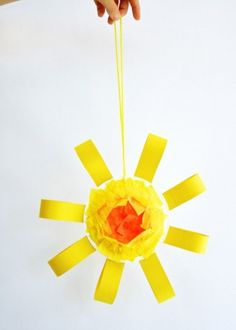 This summer sun mobile from One Charming Party is as easy to make as it is cheerful. It uses a paper plate as the center of the sun, plus yarn, tissue, paper, and colored paper. The materials are probably things you have around the house already, making this a craft that you can whip up without a lot of prepwork. #DIY