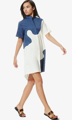 Universally flattering, the classic urban shirtdress takes a modern turn with a wave pattern
