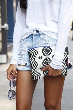 summer style. Maybe for fall, replace the shorts with jeans or leggings and the clutch with a simple bag.