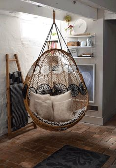 Anthropologie's swing chair with custom cushions by Chairloom.