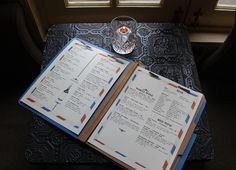 Post Office restaurant in Brooklyn, NY menu design. In a clasped folder showcasing courier text as if it was all written by a typewriter and pixelated airmail envelopes. Can I get a pulled pork sandwich please.