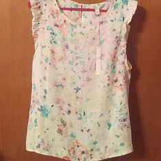 Lauren Conrad Pretty in Pleats sleeveless blouse Ivory color with pastel colors, with pleated sleeves, never been worn and still has tags on it. Lauren Conrad Tops Blouses