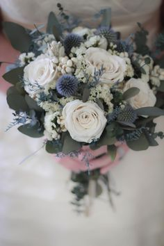 flower bouquet wedding Bridal Bouquet This dried flower wedding bouquet features dusty blue, white and gray accented with eucalyptus greenery. It has beautiful preserved roses a Hand Bouquet Wedding, Bridal Bouquet Blue, Dried Flower Bouquet, Blue Wedding Flowers, Wedding Flower Arrangements, Bridal Flowers, Bridesmaid Bouquet, Dried Flowers, Wedding Centerpieces