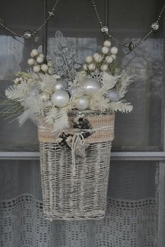 A #winter white #outdoor basket makes a great wreath alternative! The Adventures of Elizabeth