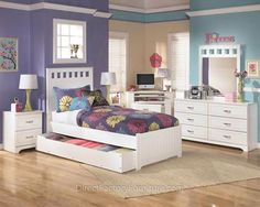 "The light airy cottage design of the ""Lulu"" youth bedroom collection features a replicated white paint finish flowing beautifully over the grooved panels and embossed bead framing to make this innovative furniture an inviting addition to any child's bedroom."