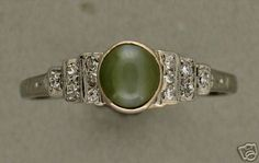 Estate 1929 Art Deco Platinum Cabochon Chrysoberyl Cat's Eye and Diamond Ring