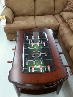 idea for our foosball.  Cut hole in plexiglas, mount on top. Make short legs for coffee table size.