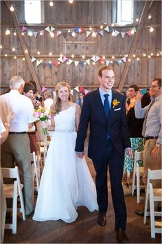 I am not a fan of this barn wedding. I think rustic can still look elegant, when done right. This looks like more of a hoe down.