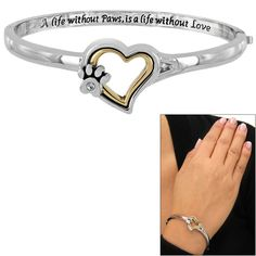 A sentimental affirmation of love for animals -- A life without paws is a life without love -- rests against your wrist on our sweetly crystal paw print and heart bangle bracelet.
