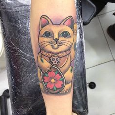 The maneki-neko (aka the Lucky Cat) tattoo. This would be a cool addition to my cherry blossoms
