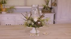How to make a fresh Christmas French inspired table arrangement using ivy, rosemary, holly and succulents, and the odd fresh flower themed to your wedding. T...