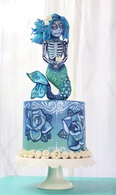 Sugar Skull Mermaid My piece for this years sugar skull bakers. She is all sculpted and painted modeling chocolate. The cake is free hand...