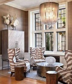 Love these taupe n cream zebra chairs. Would look Great in the desert room. This soft color tones add's a very elegant tasteful wild side.