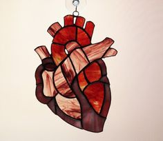 Holy cow,stained glass heart! Best stained glass hanging ever for a nurse/doctor or other medical professional! Love it!!!