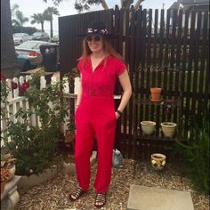 """Vintage Jumpsuit Super sweet vintage high waisted jumpsuit. Amazing embroidery and woven detail. Cool and comfy. Buttons down to waist. Two side pockets. In great vintage condition. Would fit a size S, possibly a M. Model is 5'6"""", size 4/6, 34D. Vintage Pants Jumpsuits & Rompers"""