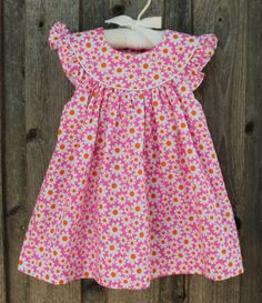 : Pink & Orange Daisy Dress from Smocked Auctions Toddler Sewing Patterns, Baby Girl Dress Patterns, Baby Dress Design, Sewing Kids Clothes, Frocks For Girls, Dresses Kids Girl, Little Girl Dresses, Kids Outfits, Kids Frocks Design